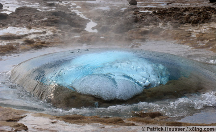a geysir shortly before it's blowout forming a beautiful sphere