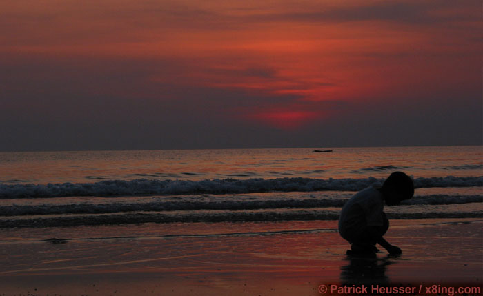 kid playing in the sunset (ko chang, thailand)